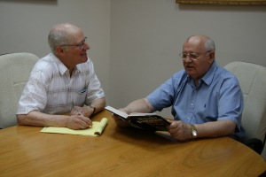 Photo of Mikhail Gorbachev checking a fact in his memoir during a meeting with the author, May 2007
